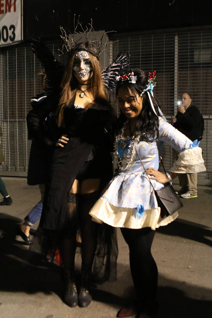Jessica Lopez, left, and Rachel Wedderburn attend the downtown Halloween parade the same day a man in a rented pickup truck mowed down pedestrians and cyclists along a busy bike path near the Worl ...