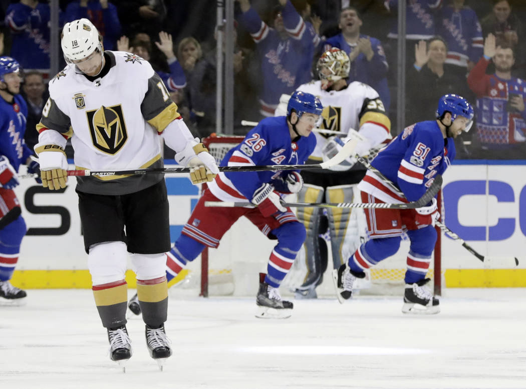 Vegas Golden Knights left wing James Neal, left, and goalie Maxime Lagace, react as New York Rangers center David Desharnais (51) and Jimmy Vesey (26) skate past him after Vesey scored a goal duri ...