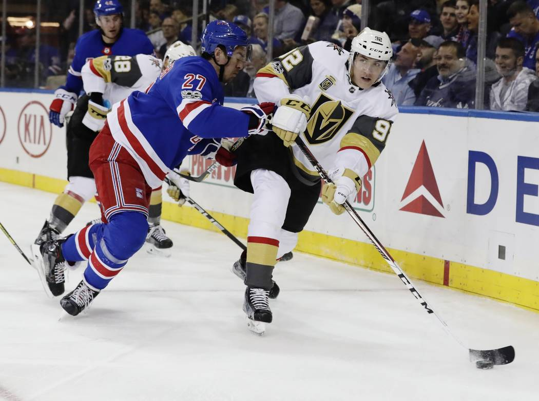 Vegas Golden Knights' Tomas Nosek (92) passes the puck away from New York Rangers' Ryan McDonagh (27) during the first period of an NHL hockey game Tuesday, Oct. 31, 2017, in New York. (AP Photo/F ...