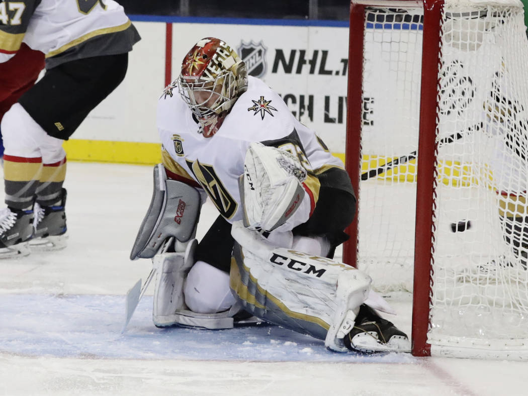 Vegas Golden Knights goalie Maxime Lagace (33) reacts as the puck shot by New York Rangers' Mats Zuccarello gets past him for a goal during the second period of an NHL hockey game Tuesday, Oct. 31 ...