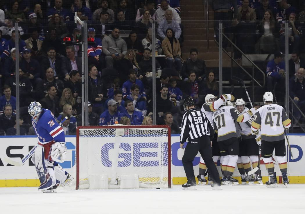 New York Rangers goalie Henrik Lundqvist (30) New York Rangers as the Vegas Golden Knights celebrate a goal by Reilly Smith during the second period of an NHL hockey game Tuesday, Oct. 31, 2017, i ...