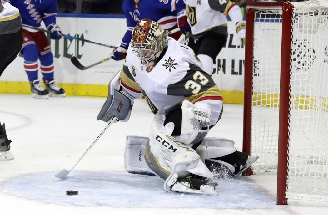 Vegas Golden Knights goalie Maxime Lagace (33) stops a shot on the goal during the second period of an NHL hockey game against the New York Rangers Tuesday, Oct. 31, 2017, in New York. (AP Photo/F ...