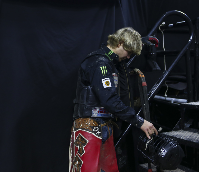 Derek Kolbaba reacts after being bucked off during the second day of the Professional Bull Riders World Finals at the T-Mobile Arena in Las Vegas on Thursday, Nov. 3, 2016. Chase Stevens/Las Vegas ...