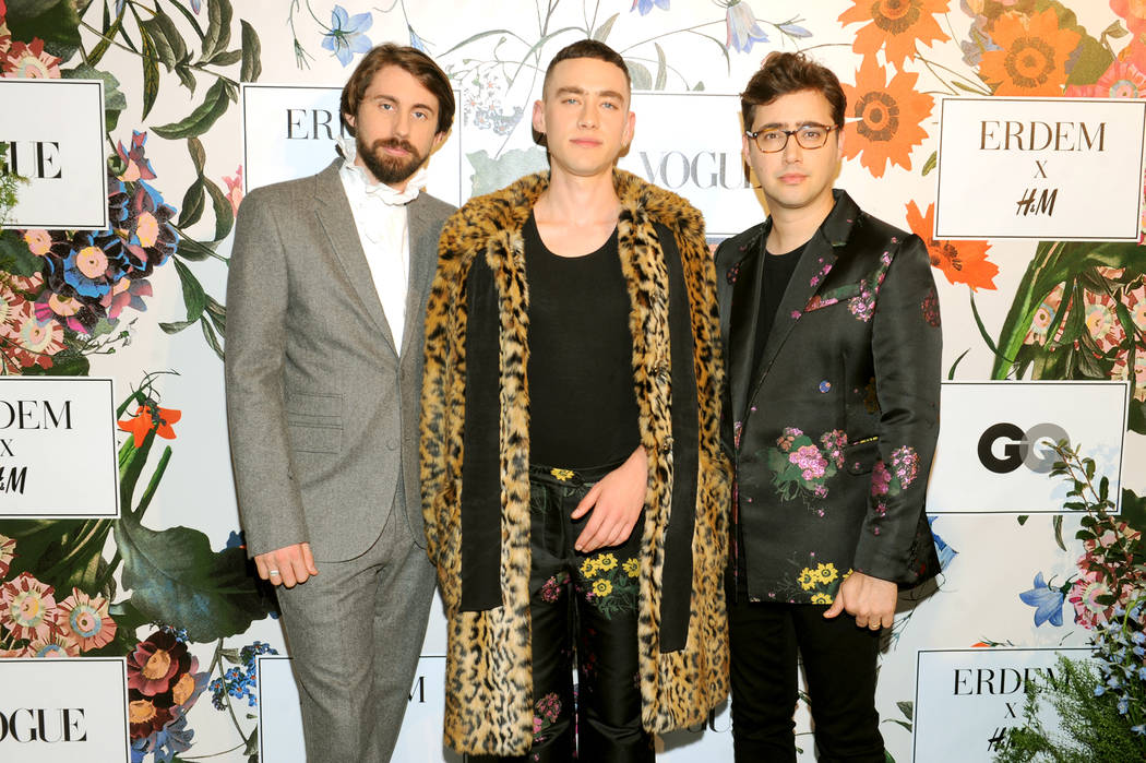 NEW YORK, NY - OCTOBER 24: (L-R) Mikey Goldsworthy, Olly Alexander, and Emre Turkmen of Years & Years attend the ERDEM X H&M Exclusive Event at H&M Flagship Fifth Avenue Store on Octob ...