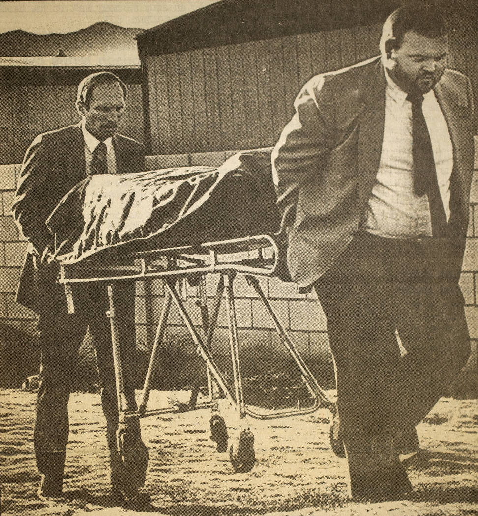 Workers from Palm Mortuary remove the body of Alexander Harris after it was found beneath a mobile home at Whiskey Pete's Casino in Stateline, now known as Primm, on Dec. 30, 1987. The 7-year-old  ...