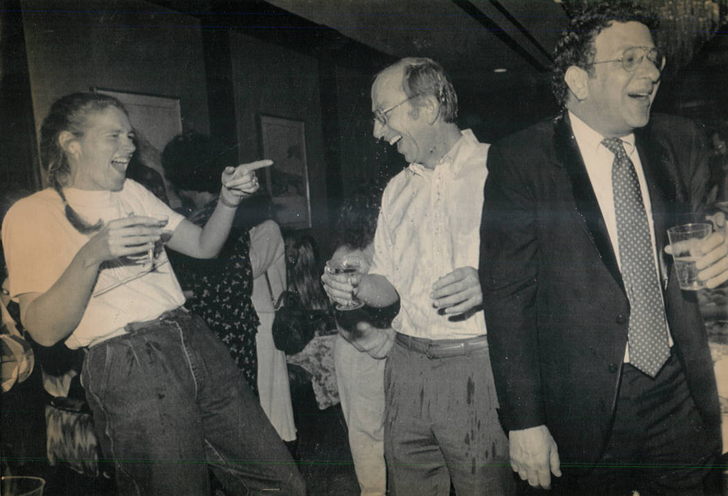 Howard Lee Haupt, center, is drenched with Champagne at a party marking his acquittal on Feb. 15, 1989, in the death of Alexander Harris. Haupt's fiancee, Tina Van Den Hazel, left, and defense att ...