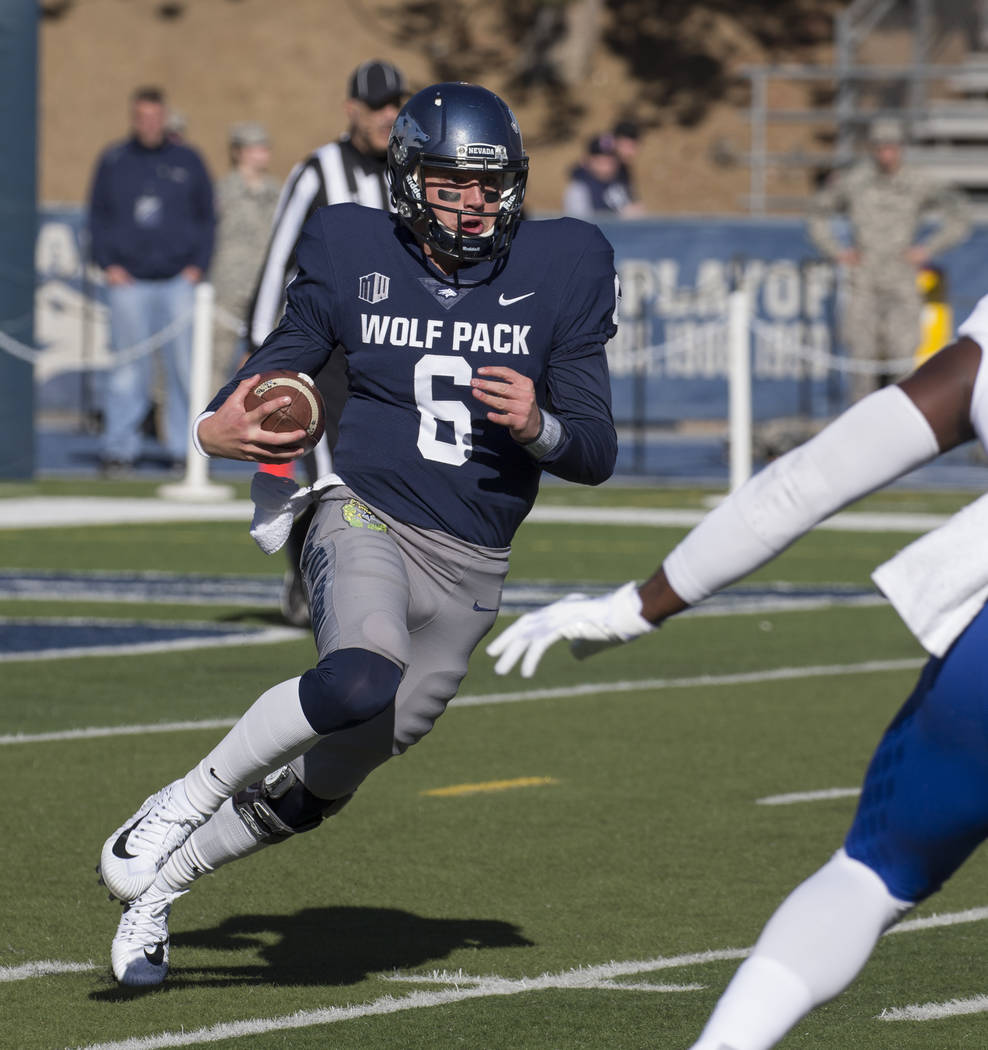 Nevada quarterback Ty Gangi (6) runs against San Jose State in the first half of an NCAA college football game in Reno, Nev., Saturday, Nov. 11, 2017. (AP Photo/Tom R. Smedes)