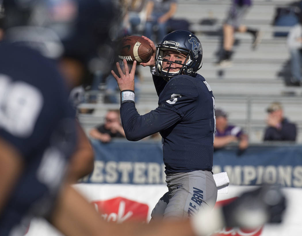 Nevada quarterback Ty Gangi looks to throw to receiver Wyatt Demps against San Jose State in the first half of an NCAA college football game in Reno, Nev. Saturday, Nov. 11, 2017. (AP Photo/Tom R. ...