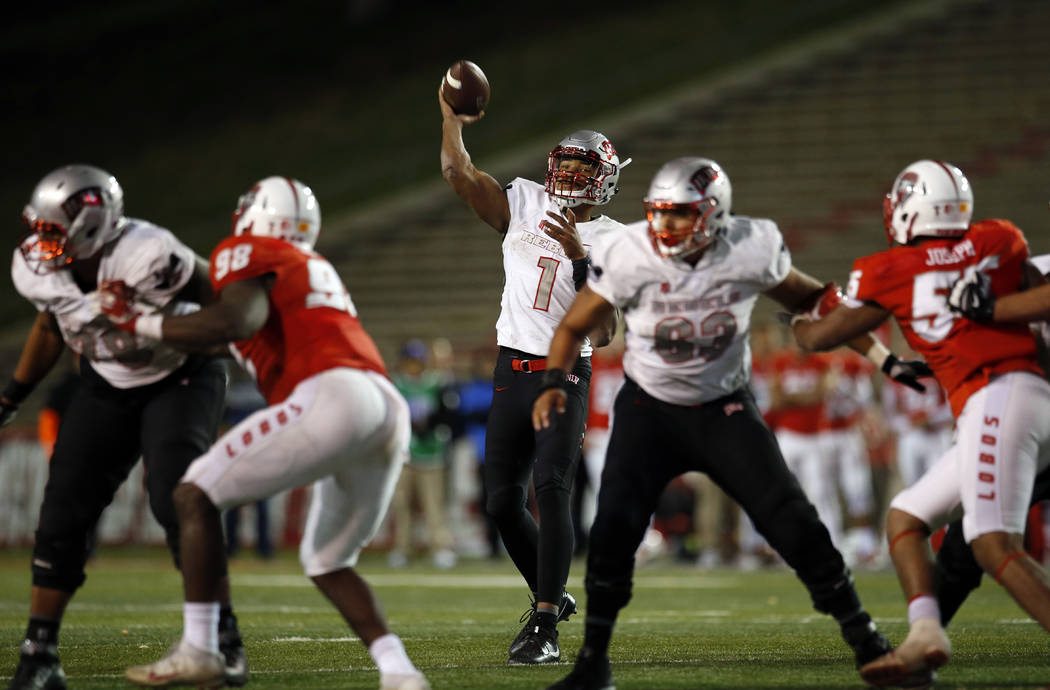 UNLV quarterback Armani Rogers (1) throws a pass against New Mexico during the second half of an NCAA college football game in Albuquerque, N.M., Friday, Nov. 17, 2017. UNLV won 38-35. (AP Photo/A ...