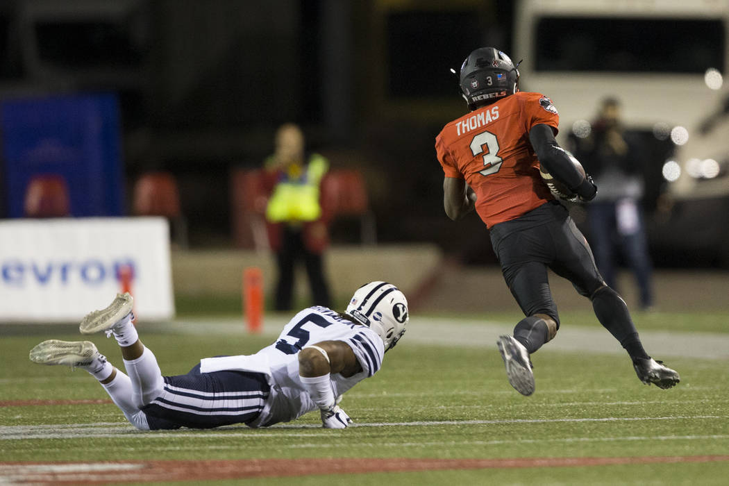 UNLV Rebels running back Lexington Thomas (3) runs the ball against Brigham Young Cougars in the football game at Sam Boyd Stadium in Las Vegas, Friday, Nov. 10, 2017. Erik Verduzco Las Vegas Revi ...