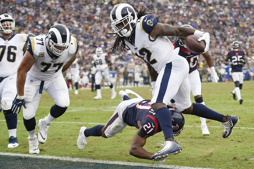 Nov 12, 2017; Los Angeles, CA, USA; Los Angeles Rams wide receiver Sammy Watkins (12) runs in for a touchdown while defended by Houston Texans safety Marcus Gilchrist (21) during the third quarter ...
