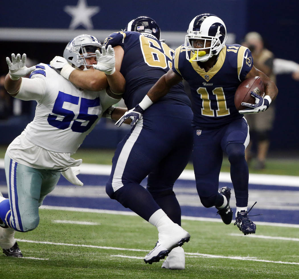 Los Angeles Rams wide receiver Tavon Austin (11) finds running room as center John Sullivan (65) defends against pressure from Dallas Cowboys defensive tackle Stephen Paea (55) in the second half  ...