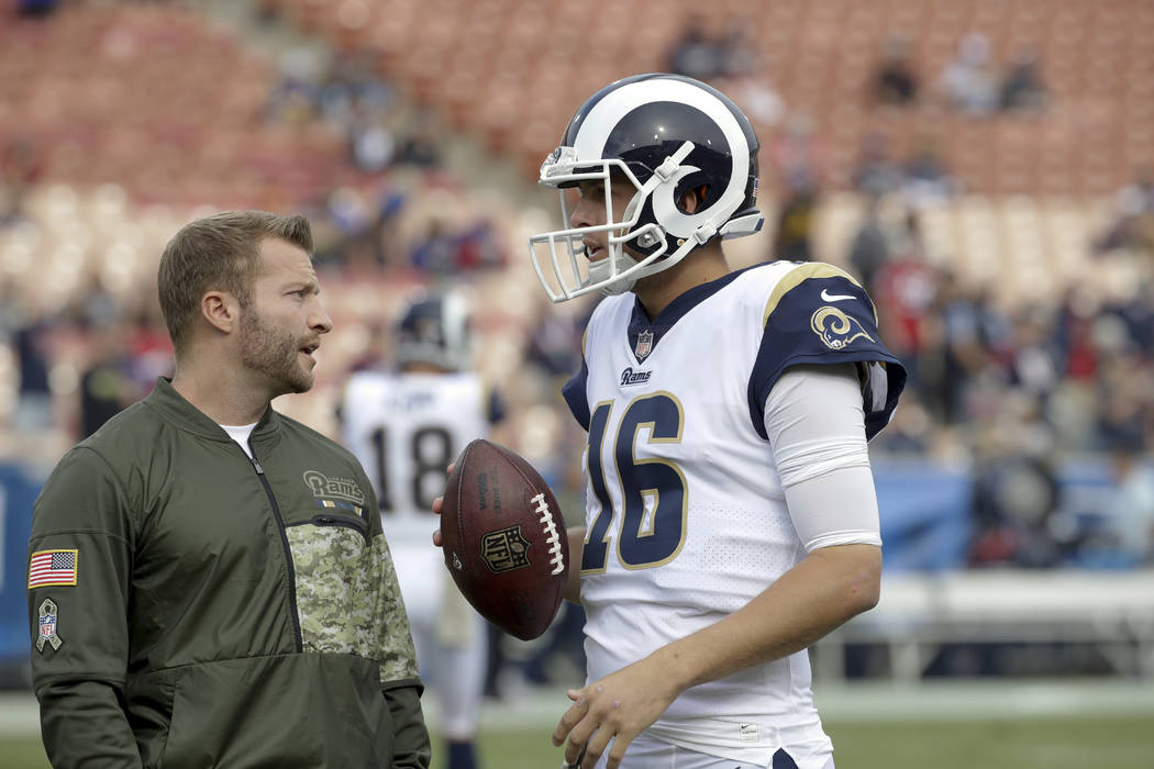 Los Angeles Rams head coach Sean McVay talks to quarterback Jared Goff before an NFL football game against the Houston Texans Sunday, Nov. 12, 2017, in Los Angeles. (AP Photo/Alex Gallardo)