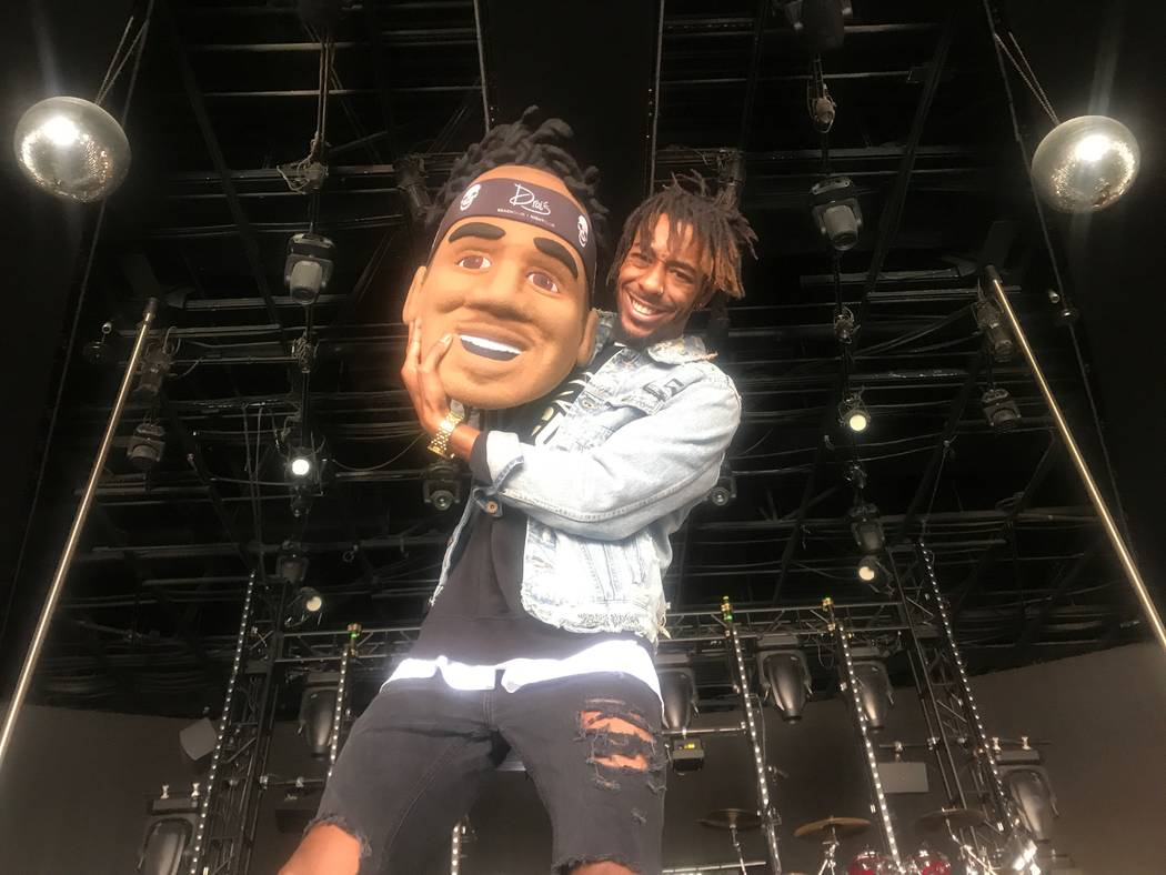 Aaron Gillam, who is Drai's Beachclub & Nightclub production coordinator and DJ Esco's official tour mascot, poses for a portrait with the mascot head on October 19, 2017 at the club. (Kailyn  ...