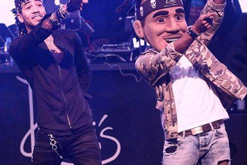 DJ Esco and his official mascot Aaron Gilliam performing on stage at Drai's Beachclub & Nightclub. (Courtesy of 2dopeboyz.com)