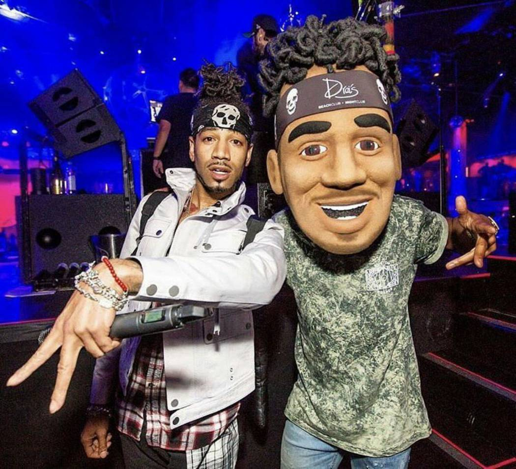DJ Esco and his official mascot Aaron Gilliam pose for a portrait. (Courtesy of EscoMoeCity Mascot on Twitter)