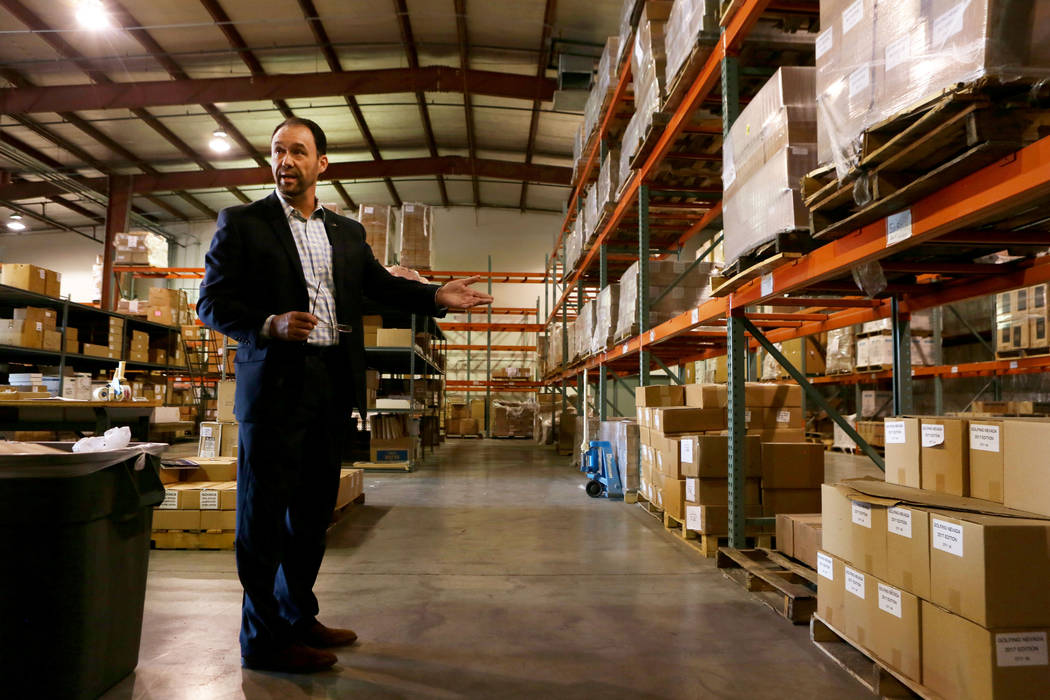 Senior vice president of finance Ed Finger gives a tour of the Las Vegas Convention and Visitors Authority warehouse in Las Vegas, Tuesday, Oct 31, 2017. The LVCVA warehouse is filled with items l ...