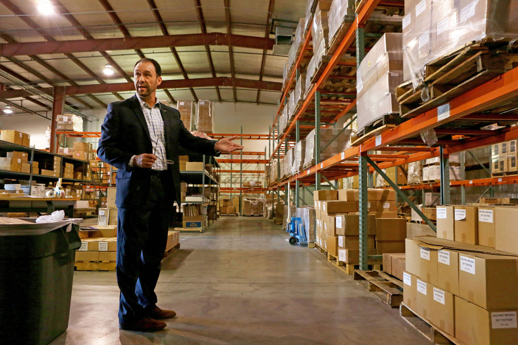 Senior vice president of finance Ed Finger gives a tour of the Las Vegas Convention and Visitors Authority warehouse in Las Vegas, Tuesday, Oct 31, 2017. The LVCVA warehouse is filled with goodies ...