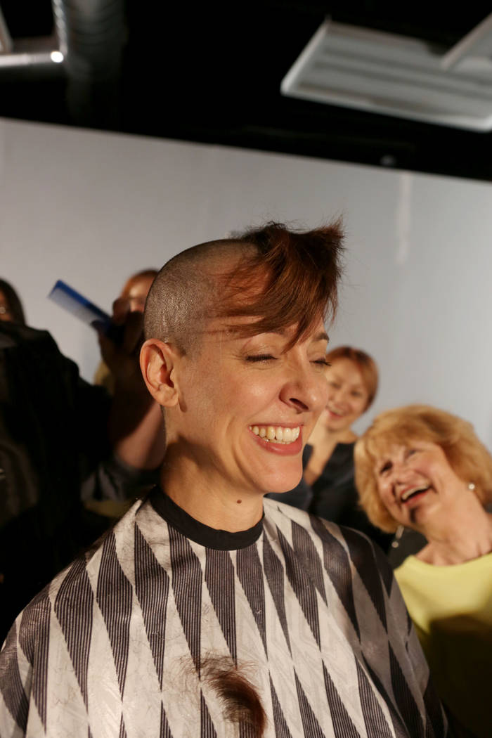 Lead actress of Wit Tina Rice's hair is shaven while Women's Cancer Center of Nevada and an ovarian cancer patient Virginia Tanedal watches during practice at A Public Fit Theatre Company in Las V ...