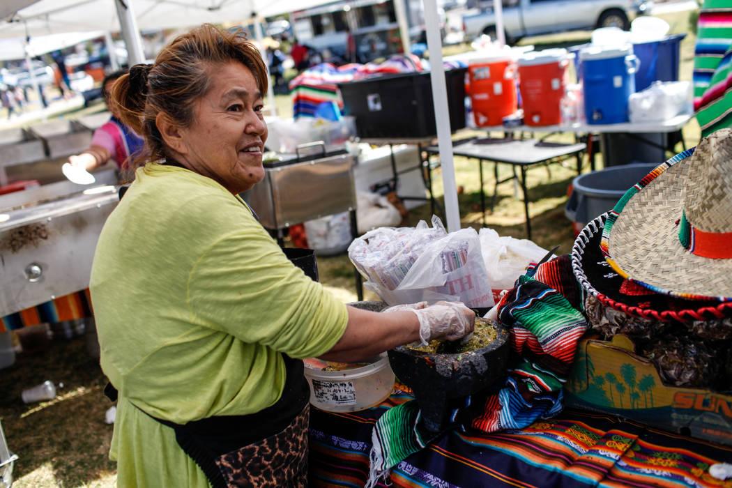 Teresa Cortes, 64, makes salsa at the Original LV Project Taco festival in North Las Vegas, Saturday, Nov. 4, 2017. Joel Angel Juarez Las Vegas Review-Journal @jajuarezphoto