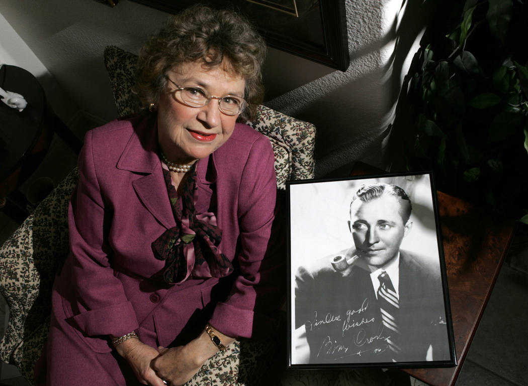 This Nov. 20, 2007 file photo shows Bing Crosby's niece Carolyn Schneider posing with a photo of Crosby in Las Vegas. Schneider, Bing Crosby's niece, visited her uncle on his Elko County, Nev., sp ...