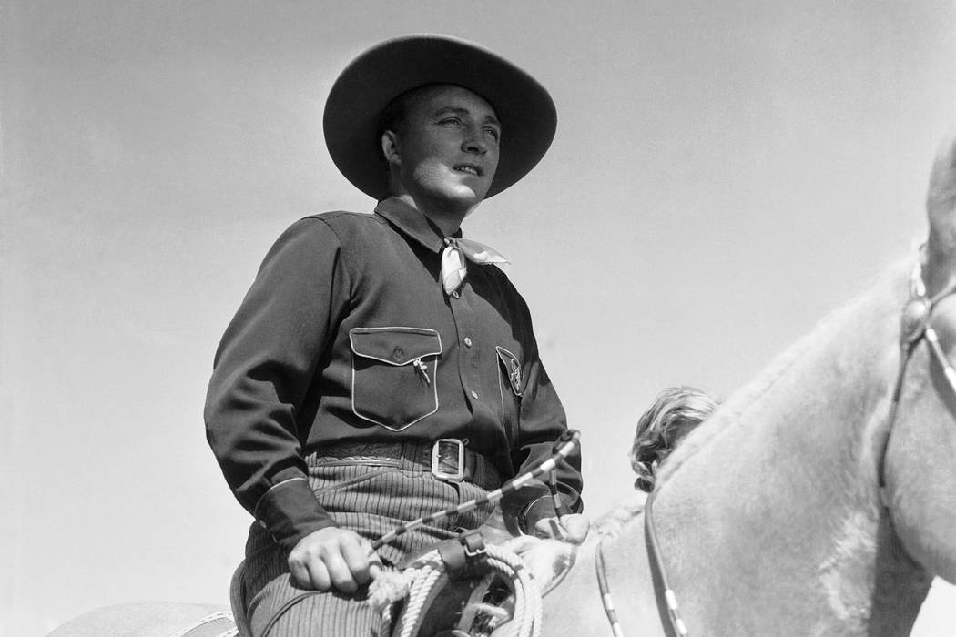 "Bing Crosby shown in cowboy regalia in Hollywood, Los Angeles on July 3, 1936 as he rides the range singing to the cattle and a girl in his next picture, ""Rhythm on the Range."" ( ..."
