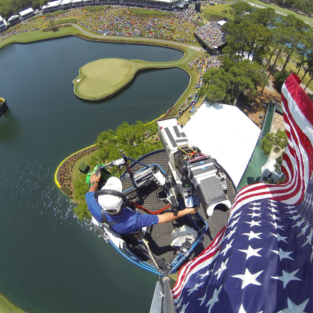 Golf Channel cameraman John Boeddeker is seen from his perch above the No. 17 green at the TPC at Sawgrass in Ponte Vedra Beach, Florida. (Courtesy: John Boeddeker)