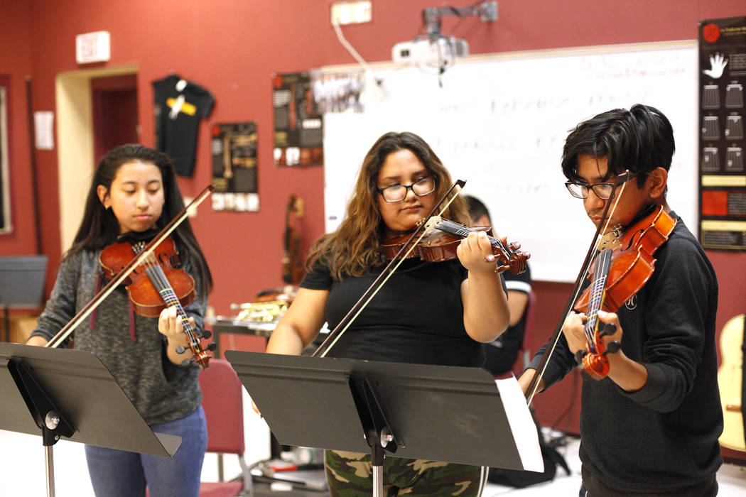 Glenda Torres, 14, from left, Diaany Pineda, 14, and Angel Sandoval, 14, play violins during mariachi class at El Dorado High School in Las Vegas, Wednesday, Oct. 18, 2017. Rachel Aston Las Vegas  ...