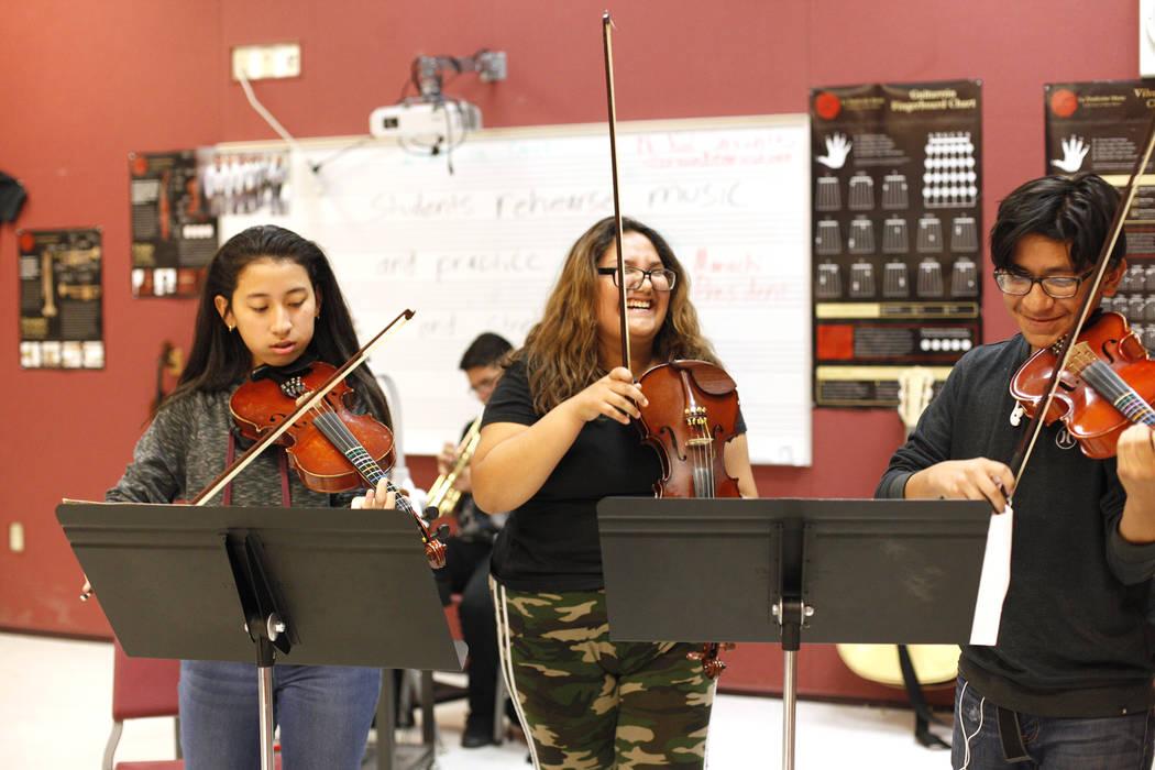 Glenda Torres, 14, from left, Diaany Pineda, 14, and Angel Sandoval, 14, play violins during mariachi class at El Dorado High School in Las Vegas, Wednesday, Oct. 18, 2017. Rachel Aston Las Vegas  ...