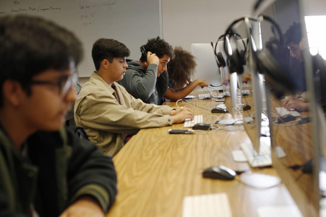 Carlos Alvarez, 16, center, and Rogelio Saldivar, 16, right, work on the computer in a video game development class at El Dorado High School in Las Vegas, Wednesday, Oct. 18, 2017. The school has  ...