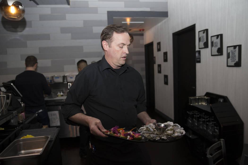 Shepherd McFarlane delivers food to costumers at The Black Sheep restaurant in Las Vegas, Friday, Oct. 27, 2017. Erik Verduzco Las Vegas Review-Journal @Erik_Verduzco