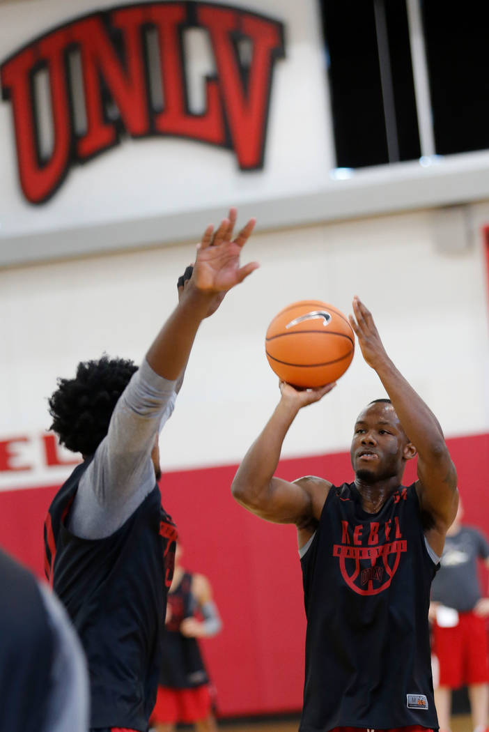 UNLV basketball player Jordan Johnson, right, shoots over his teammate Jovan Mooring during their practice at the Mendenhall Center in Las Vegas, Saturday, Sept. 30, 2017. Chitose Suzuki Las Vegas ...