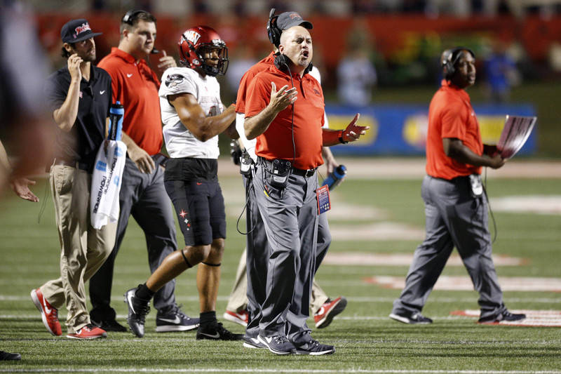 Oct 28, 2017; Fresno, CA, USA; UNLV Rebels head coach Tony Sanchez stands on the field during a timeout against the Fresno State Bulldogs in the second quarter at Bulldog Stadium. Mandatory Credit ...