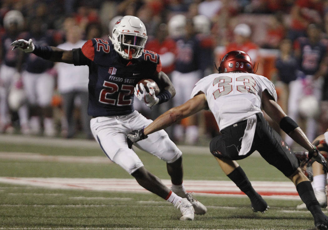 Fresno State's running back Jordan Mims tries to go around UNLV's Dalton Baker during the first half of an NCAA college football game in Fresno, Calif., Saturday, Oct. 28 2017. (AP Photo/Gary Kaza ...