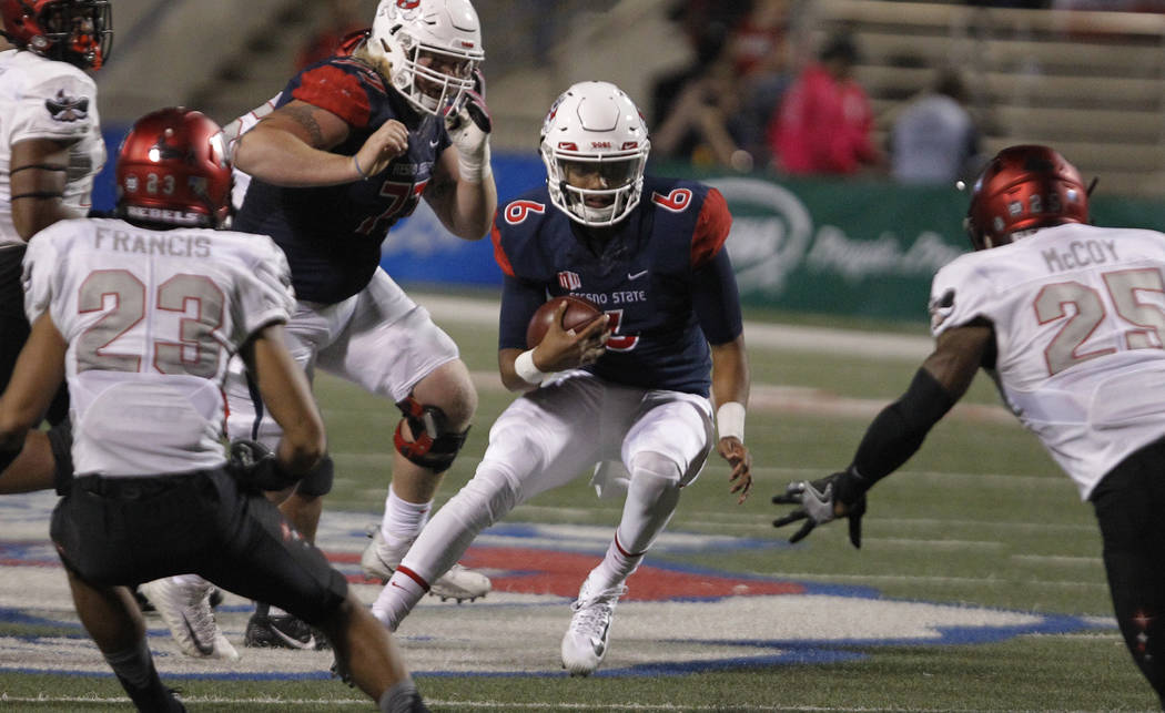 UNLV's Gabe McCoy, far right, tries to tackle Fresno State's Marcus McMaryion during the first half of an NCAA college football game in Fresno, Calif., Saturday, Oct. 28 2017. (AP Photo/Gary Kazan ...