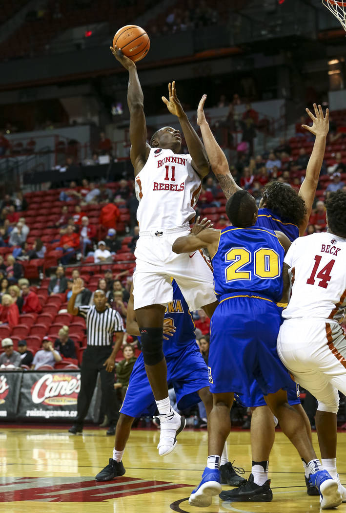 UNLV Rebels forward Cheickna Dembele (11) attempts a shot against the Alaska Nanooks during an exhibition basketball game at the Thomas & Mack, Friday, Nov. 3, 2017. UNLV defeated the Nanooks  ...