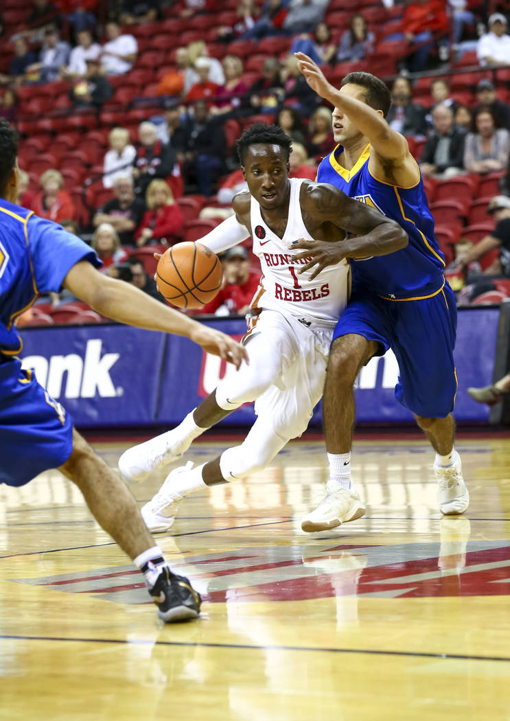 UNLV Rebels guard Kris Clyburn (1) drives the ball past  an Alaska Nanooks defender during an exhibition basketball game at the Thomas & Mack, Friday, Nov. 3, 2017. UNLV defeated the Nanooks 9 ...