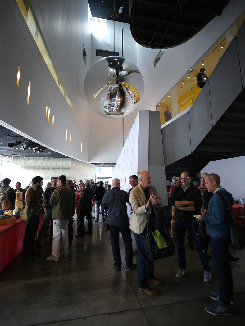 Visitors enjoy a reception under the Orbital Reflector art piece at the Nevada Museum of Art in Reno on Friday, Oct. 20, 2017. Cathleen Allison/Las Vegas Review-Journal