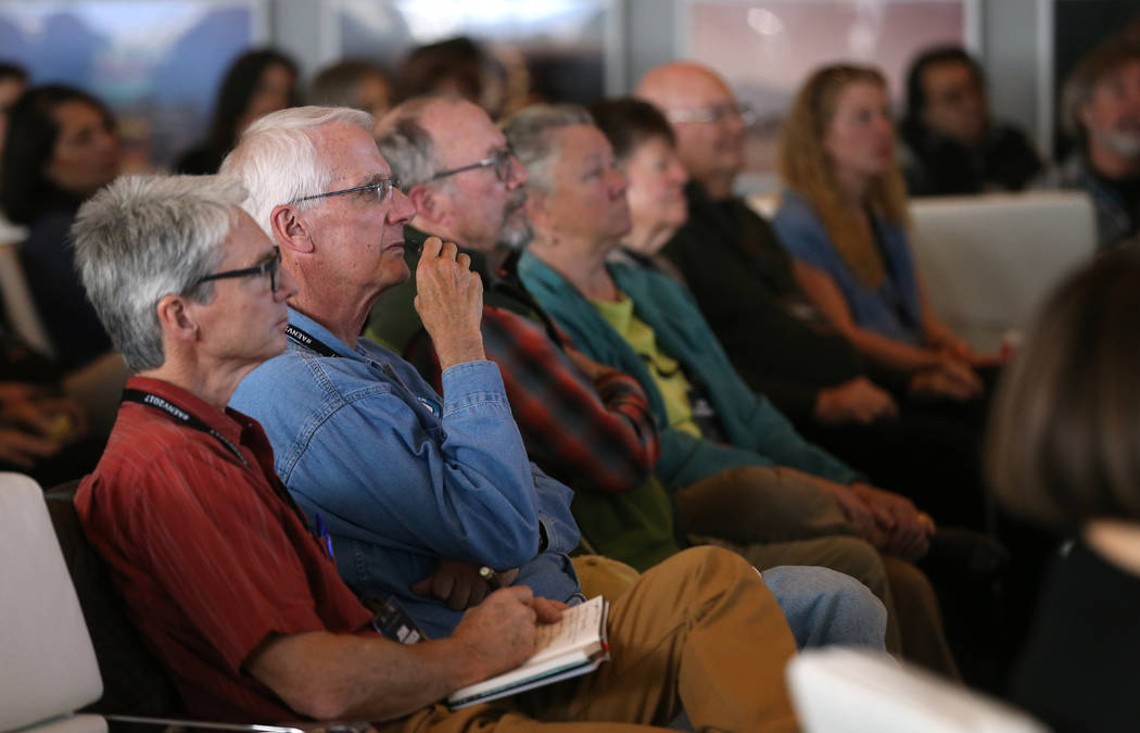 Visitors listen as artist Trevor Paglen gives a presentation about his Orbital Reflector art piece at the Nevada Museum of Art in Reno on Friday, Oct. 20, 2017. The 14-foot model at the museum is  ...