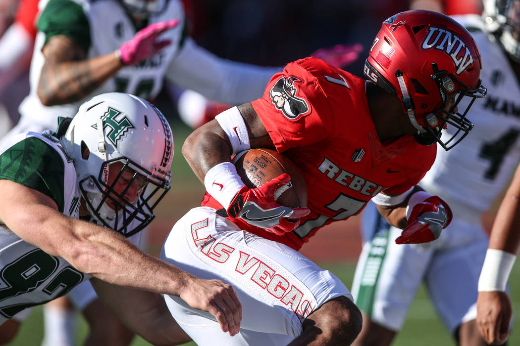 UNLV Rebels defensive back Jericho Flowers (7) runs the ball past the Hawaii Warriors during the first quarter of a football game at Sam Boyd Stadium in Las Vegas, Saturday, Nov. 4, 2017. UNLV won ...