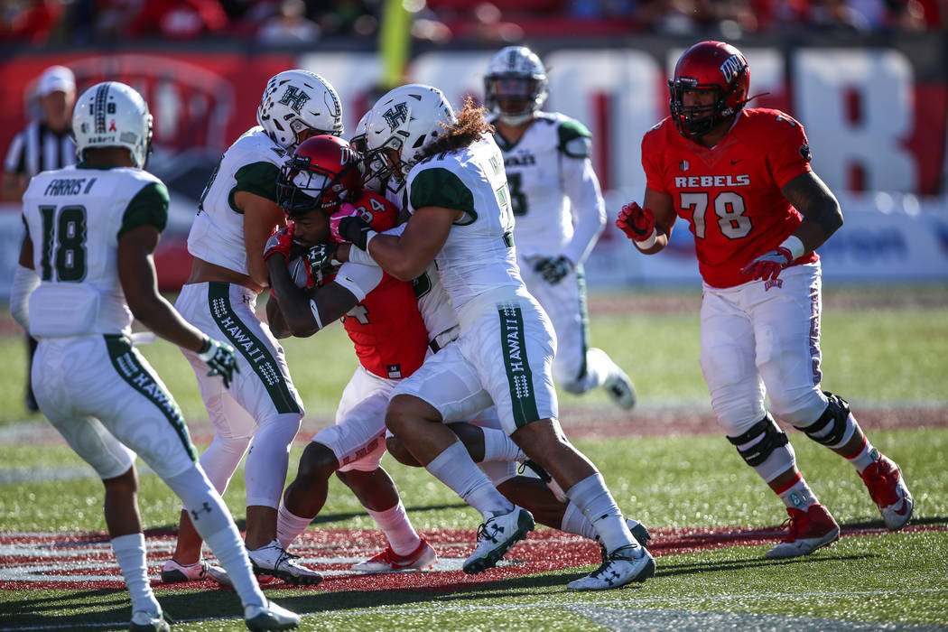 UNLV Rebels wide receiver Kendal Keys (84) is tackled by the Hawaii Warriors during the first quarter of a football game at Sam Boyd Stadium in Las Vegas, Saturday, Nov. 4, 2017. UNLV won 31-23. J ...