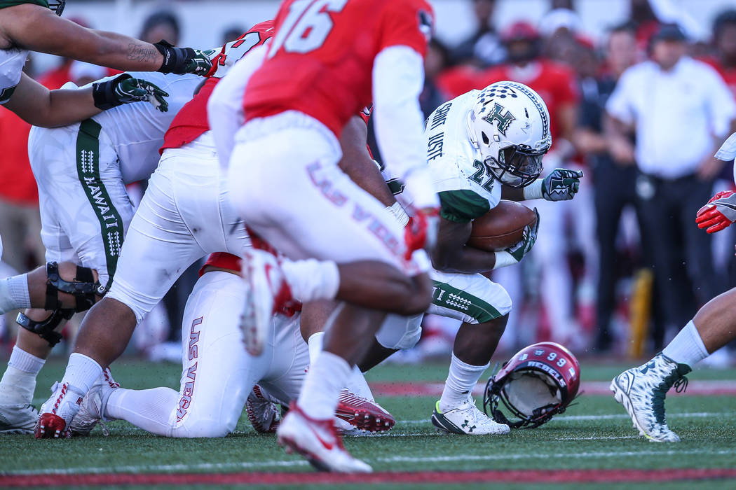 Hawaii Warriors running back Diocemy Saint Juste (22) runs the ball against the UNLV Rebels during the second quarter of a football game at Sam Boyd Stadium in Las Vegas, Saturday, Nov. 4, 2017. U ...