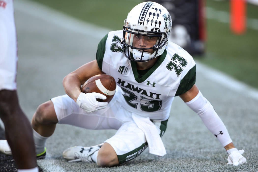Hawaii Warriors wide receiver Dylan Collie (23) scores a touchdown against the UNLV Rebels during the third quarter of a football game at Sam Boyd Stadium in Las Vegas, Saturday, Nov. 4, 2017. UNL ...