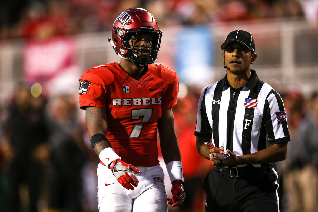 UNLV Rebels defensive back Jericho Flowers (7) is given a penalty against the Hawaii Warriors during the fourth quarter of a football game at Sam Boyd Stadium in Las Vegas, Saturday, Nov. 4, 2017. ...