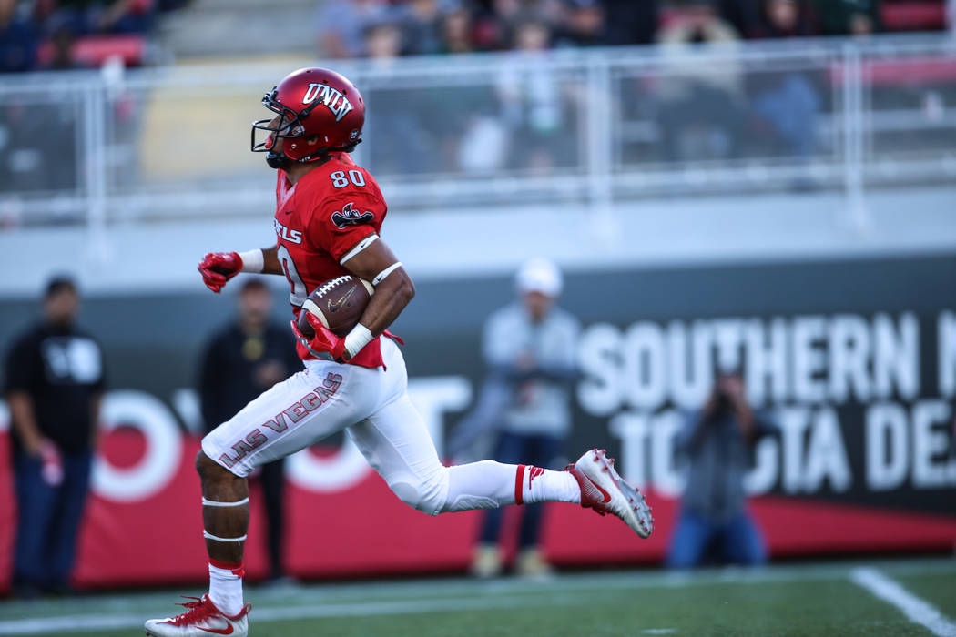 UNLV Rebels wide receiver Brandon Presley (80) runs the ball for a touchdown against against the Hawaii Warriors during the third quarter of a football game at Sam Boyd Stadium in Las Vegas, Satur ...