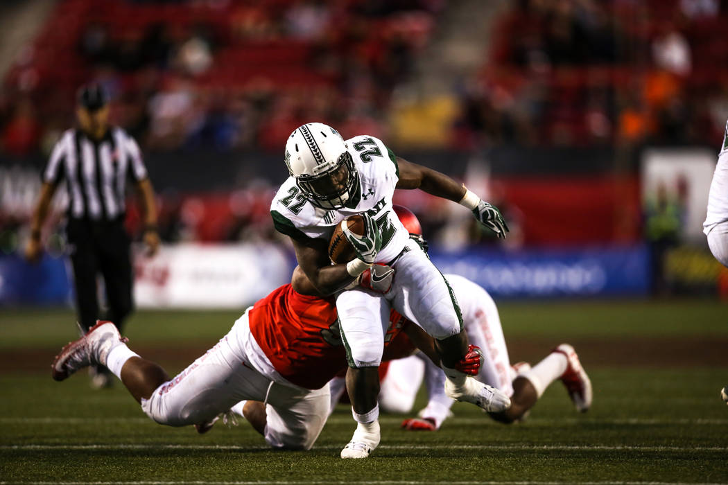 Hawaii Warriors running back Diocemy Saint Juste (22) runs the ball against the UNLV Rebels during the fourth quarter of a football game at Sam Boyd Stadium in Las Vegas, Saturday, Nov. 4, 2017. U ...