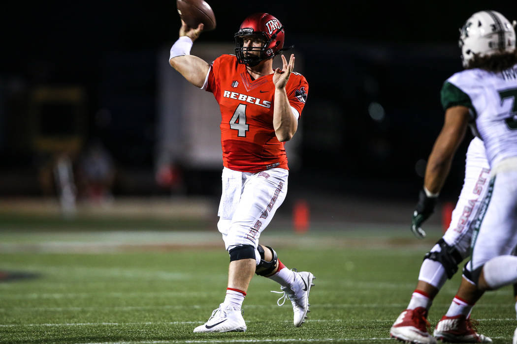 UNLV Rebels quarterback Johnny Stanton (4) passes the ball against the Hawaii Warriors during the fourth quarter of a football game at Sam Boyd Stadium in Las Vegas, Saturday, Nov. 4, 2017. UNLV w ...