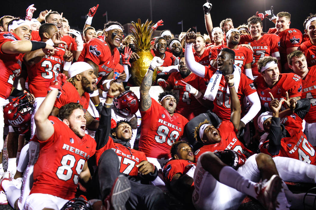 UNLV Rebels celebrate after defeating the Hawaii Warriors 31-23 at Sam Boyd Stadium in Las Vegas, Saturday, Nov. 4, 2017. Joel Angel Juarez Las Vegas Review-Journal @jajuarezphoto
