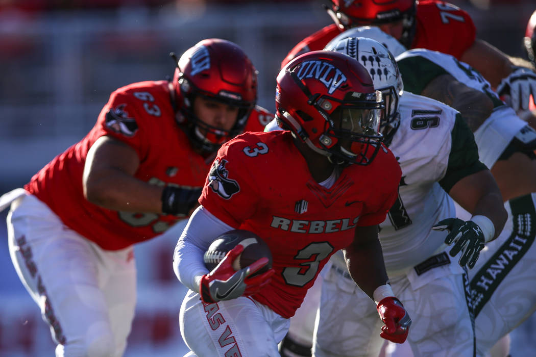 UNLV Rebels running back Lexington Thomas (3) runs the ball against the Hawaii Warriors during the first quarter of a football game at Sam Boyd Stadium in Las Vegas, Saturday, Nov. 4, 2017. UNLV w ...