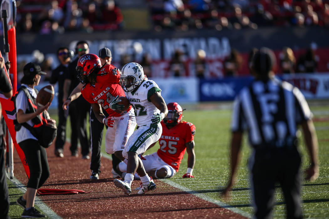 Hawaii Warriors running back Diocemy Saint Juste (22) runs the ball against UNLV Rebels during the second quarter of a football game at Sam Boyd Stadium in Las Vegas, Saturday, Nov. 4, 2017. UNLV  ...